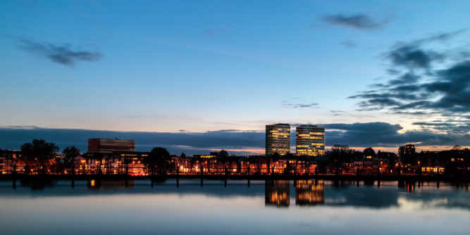 Evening view of the central railway station area with offices in the Dutch city of Arnhem